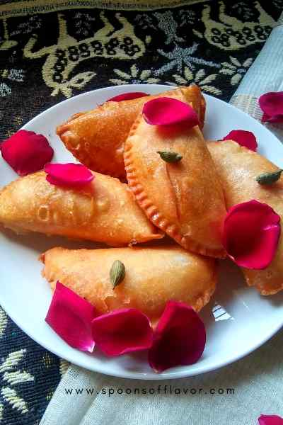 It is a crispy, flaky sweet Indian pastry stuffed with coconut and sweetened mawa savored during Holi and Diwali - Spoons Of Flavor